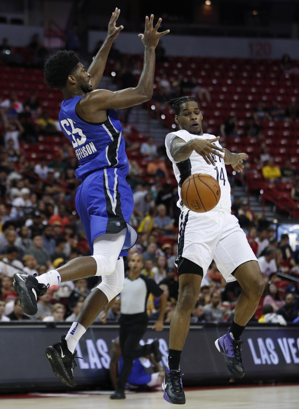 Brooklyn Nets' Ahmed Hill, right, blocks a pass from Orlando Magic's Amile Jefferson during the second half of an NBA summer league basketball game We