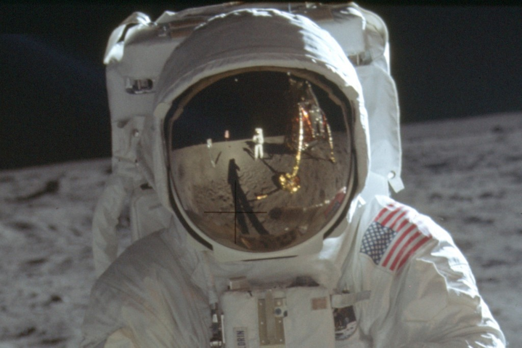 This detail of a July 20, 1969 photo made available by NASA shows astronaut Neil Armstrong reflected in the helmet visor of Buzz Aldrin on the surface