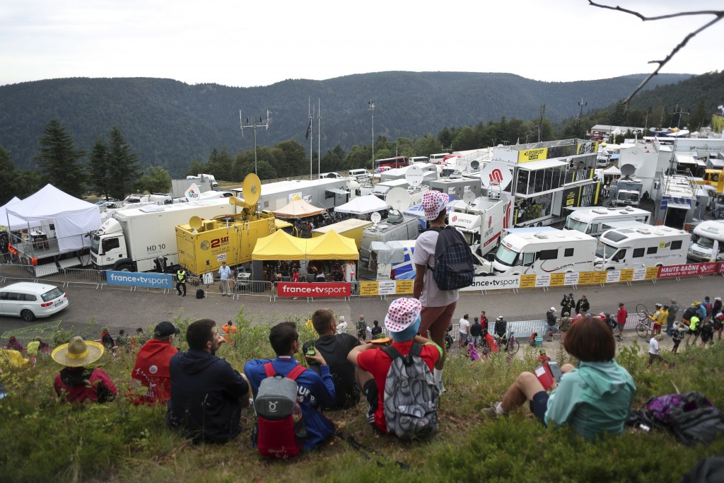 Spectators stand next to the finish line of the sixth stage of the Tour de France cycling race over 160 kilometers (100 miles) with start in Mulhouse