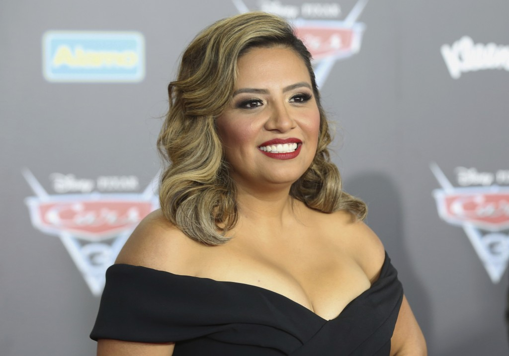 """FILE - This June 10, 2017 file photo shows Cristela Alonzo at the LA Premiere of """"Cars 3"""" in Anaheim, Calif. Alonzo is telling her story in words and"""