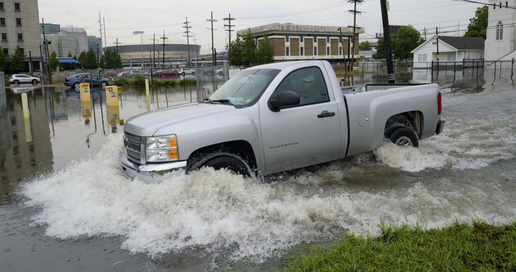 A truck passes by the University Medical Center (UMC) with the Mercedes-Benz Superdome in the background on Glavez Street in New Orleans after floodin