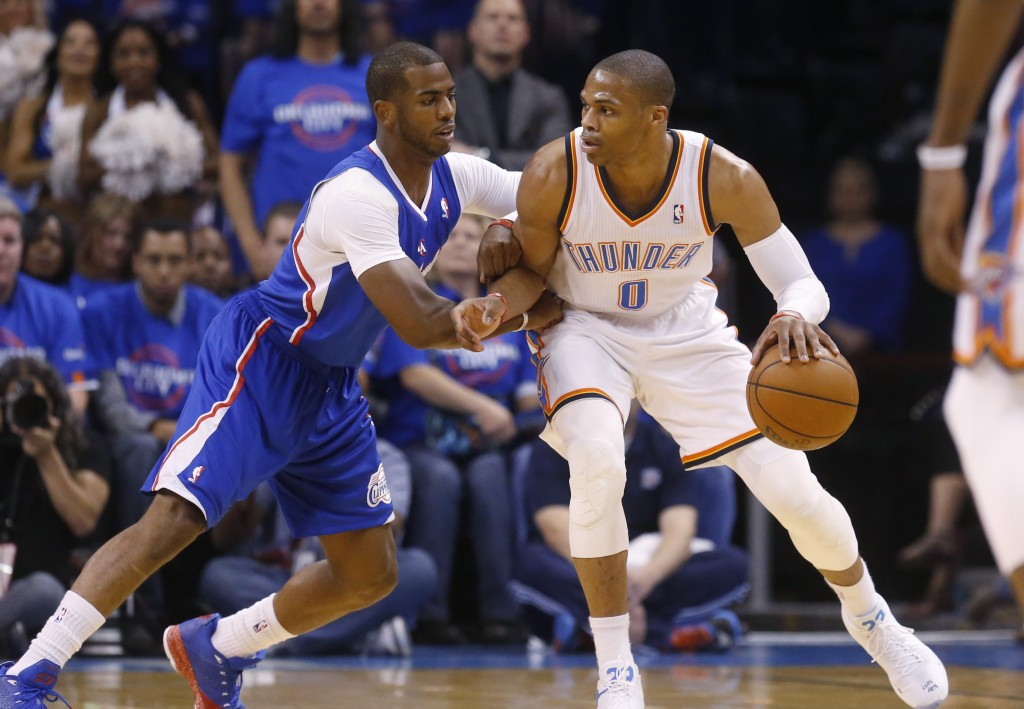 FILE - In this Monday, May 5, 2014 file photo, Oklahoma City Thunder guard Russell Westbrook (0) drives against Los Angeles Clippers guard Chris Paul