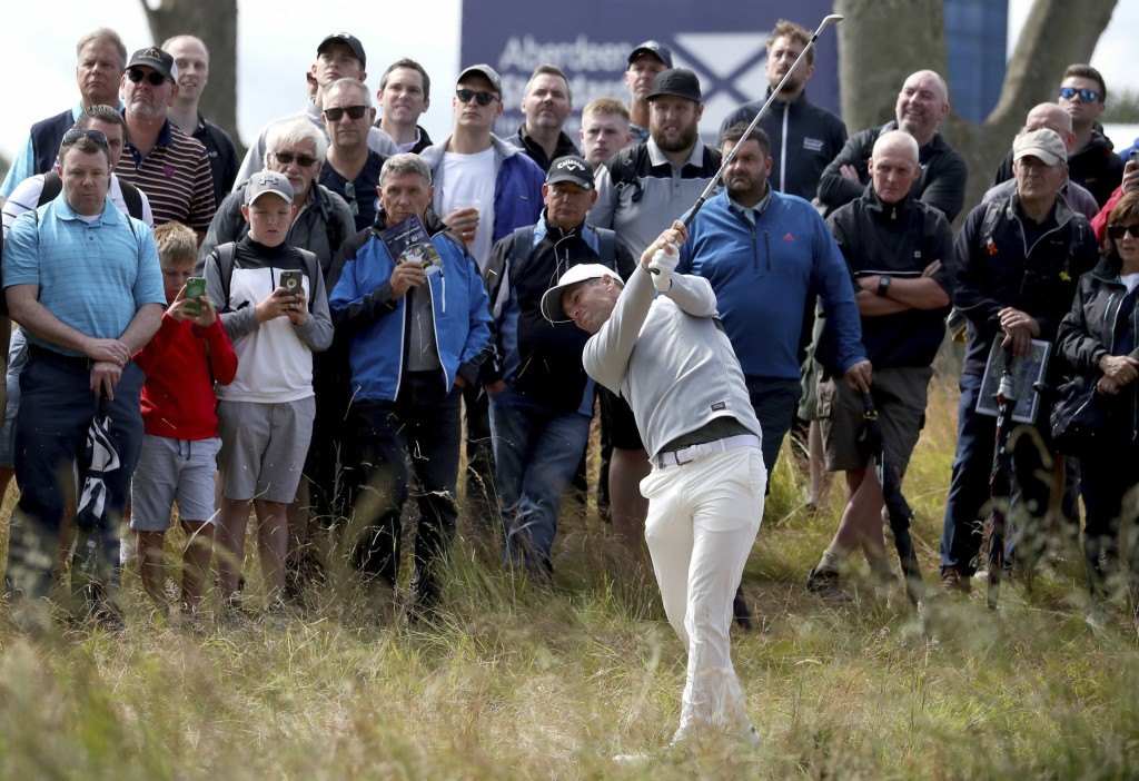 Denmark's Lucas Bjerregaard hits out of the rough on the 1st hole during the Scottish Open golf tournament at The Renaissance Club, in North Berwick, ...