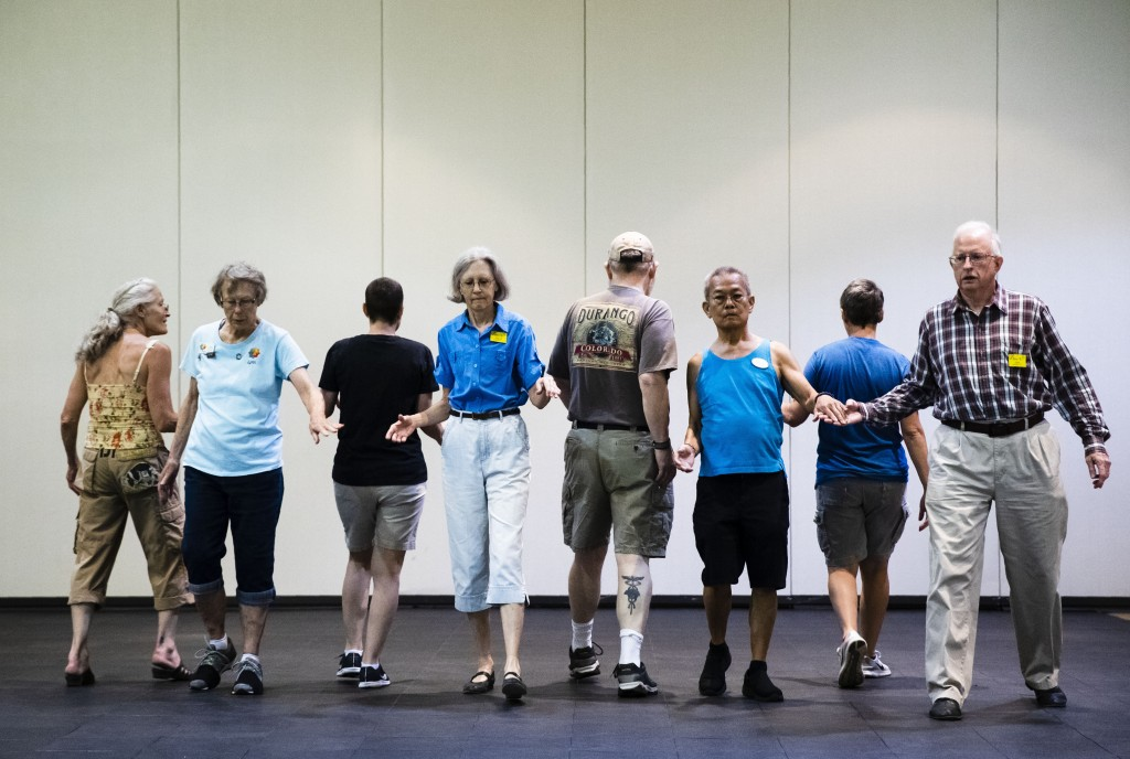 This July 3, 2019 photo shows people participating during the annual International Association of Gay Square Dance Clubs convention in Philadelphia. T