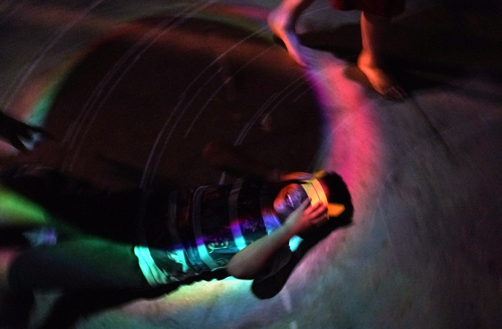 Byron Xol, an immigrant from Guatemala, lies on the floor in a makeshift disco ball room during his birthday party Sunday, June 23, 2019, in Buda, Tex...