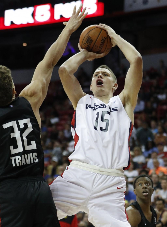 Washington Wizards Moritz Wagner shoots over Atlanta Hawks' Reid Travis during the first half of an NBA summer league basketball game Thursday, July 1...
