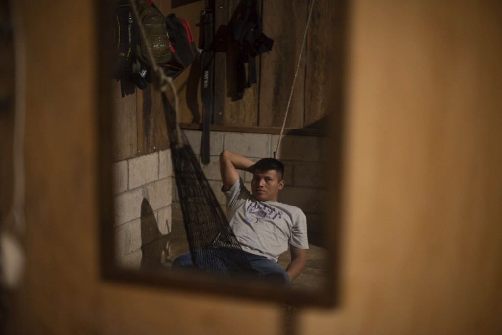 David Xol lies in a hammock in his one-bedroom home in San Miguel El Limon, 475 kilometers (295 miles) away from Guatemala City, Sunday, June, 23, 201...