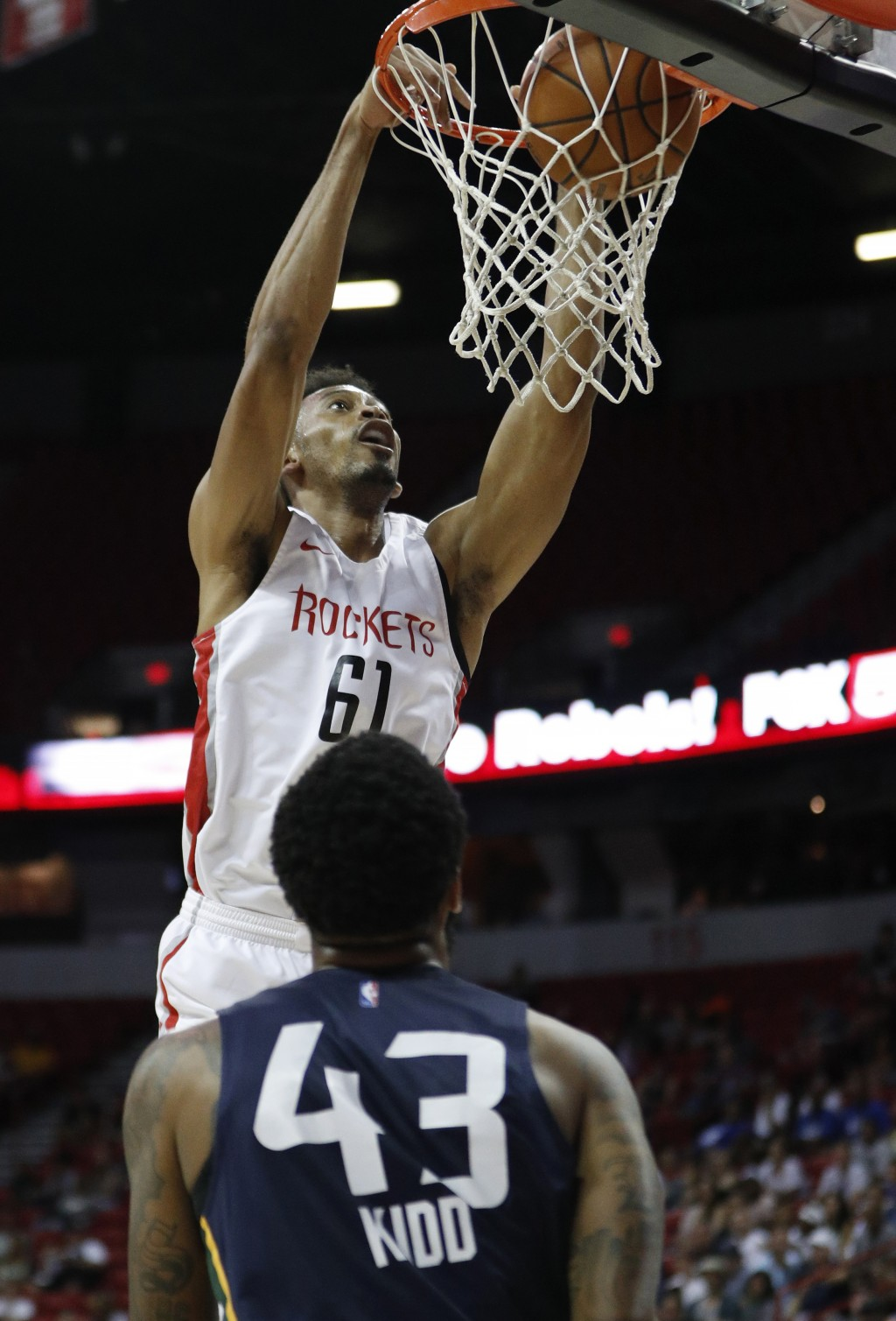 Houston Rockets' Johnathan Williams dunks against the Utah Jazz during the first half of an NBA summer league basketball game Thursday, July 11, 2019,...