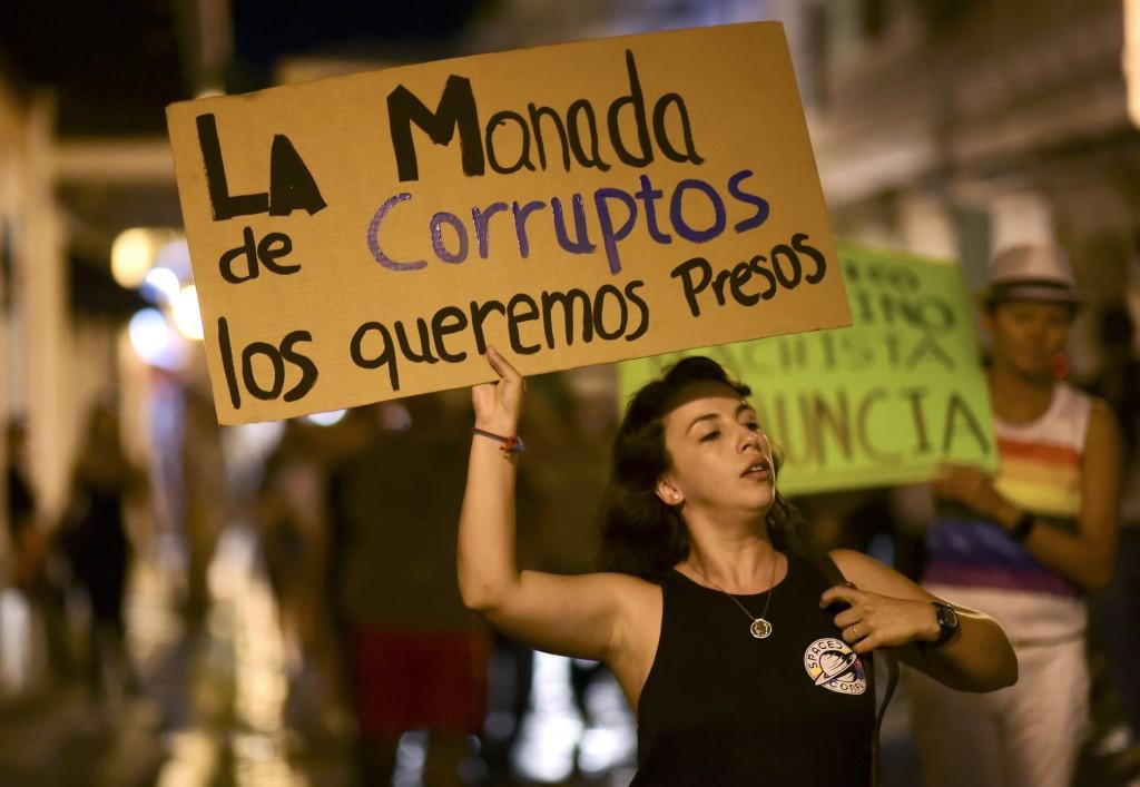Dozens of citizens protest near the executive mans...