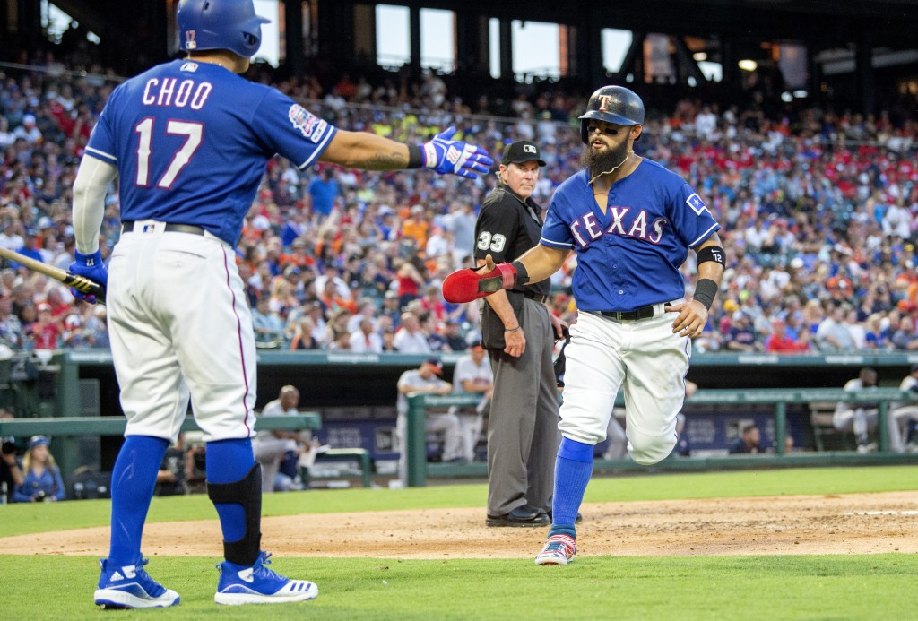 Texas Rangers' Rougned Odor, right, is congratulated by Shin-Soo Choo (17) after scoring on an RBI single by Jeff Mathis during the third inning of a ...