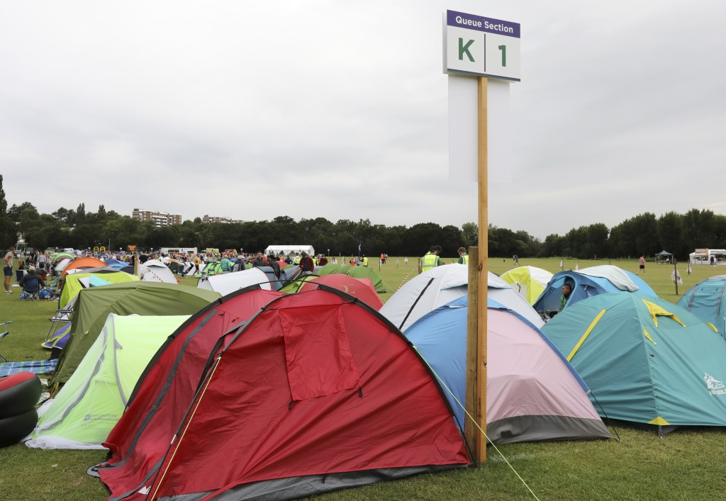 In this Tuesday, July 9, 2019, the tents of tennis fans are queued up to get tickets to enter the Wimbledon Tennis Championships in London. For many t