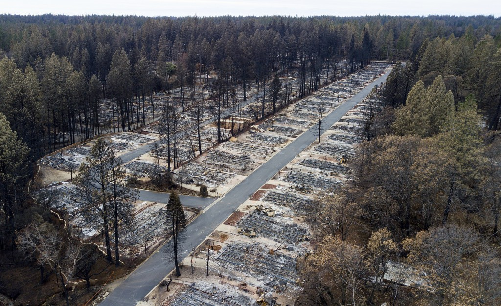 FILE- In this Dec. 3, 2018, file photo, homes leveled by the Camp Fire line the Ridgewood Mobile Home Park retirement community in Paradise, Calif. Ne