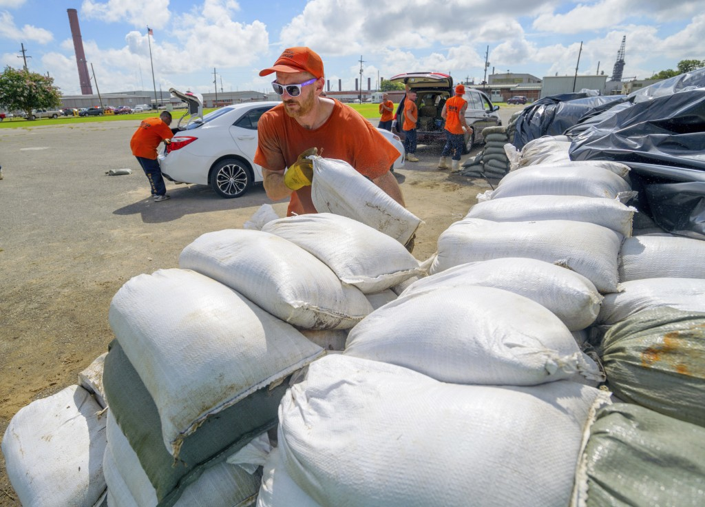St. Bernard Parish Sheriff's Office inmate workers move free sandbags for residents in Chalmette, La., Thursday, July 11, 2019. The Mississippi Emerge...