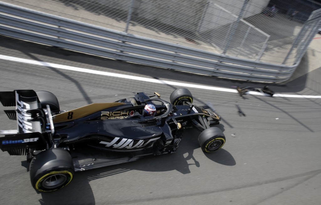 Haas driver Romain Grosjean of France crashes into the guardrails coming out of the pitlane at the start of the first free practice at the Silverstone...