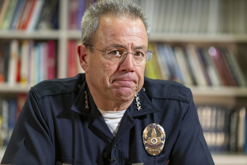 In this Wednesday, July 10, 2019 photo Los Angeles Police Department Chief Michel Moore pauses during an interview with The Associated Press in Los An...