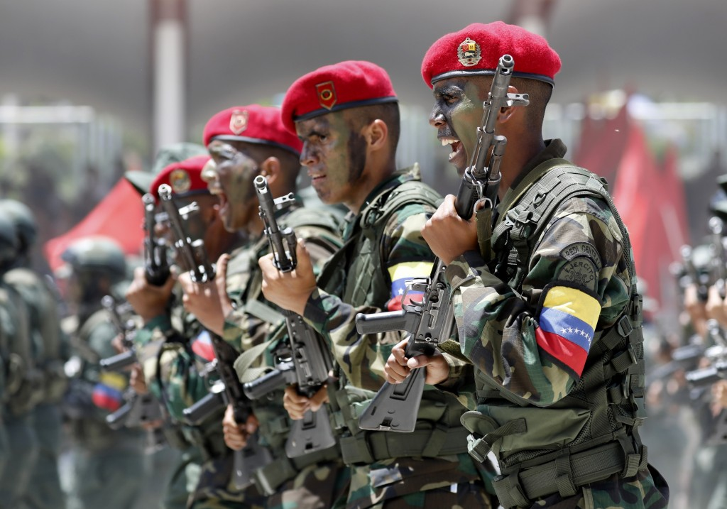 In this Friday July 5, 2019 photo, soldiers march during a military parade marking Independence Day in Caracas. Venezuela is marking 208 years of thei