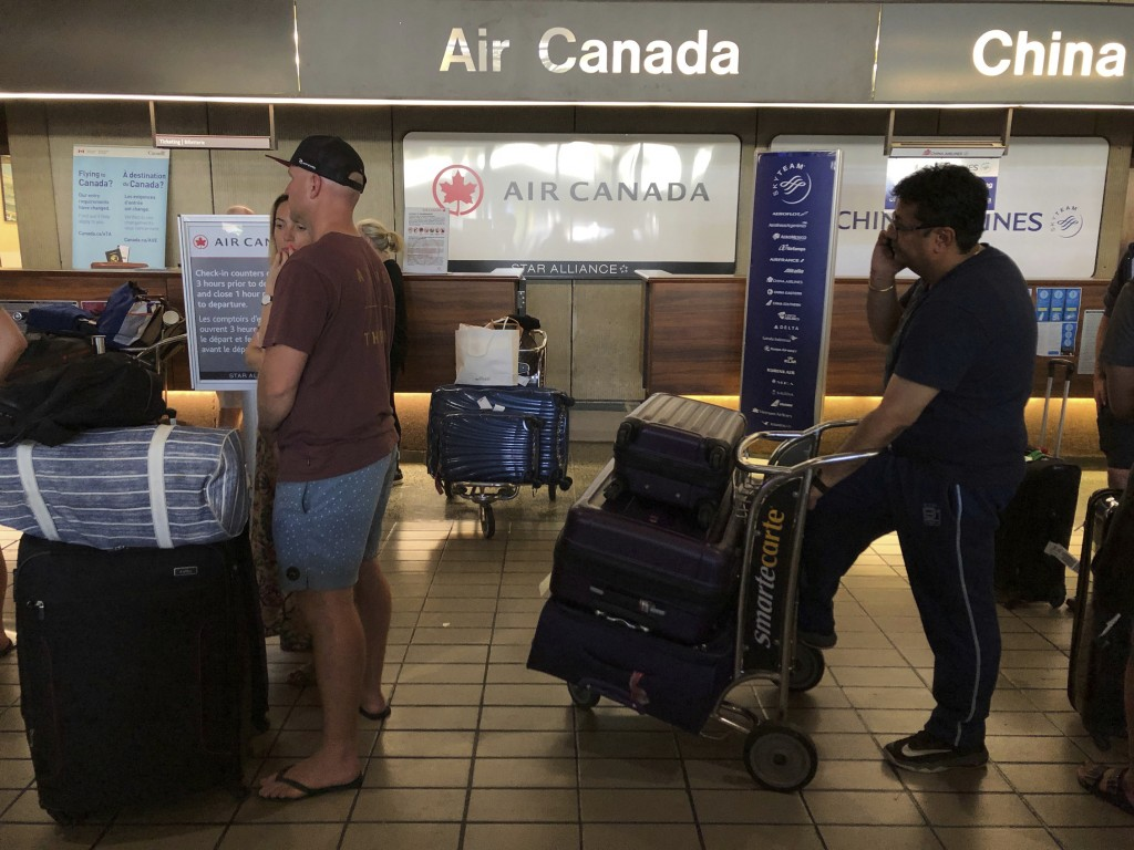 Passengers from an Australia-bound Air Canada flight diverted to Honolulu Thursday, July 11, 2019, after about 35 people were injured during turbulenc
