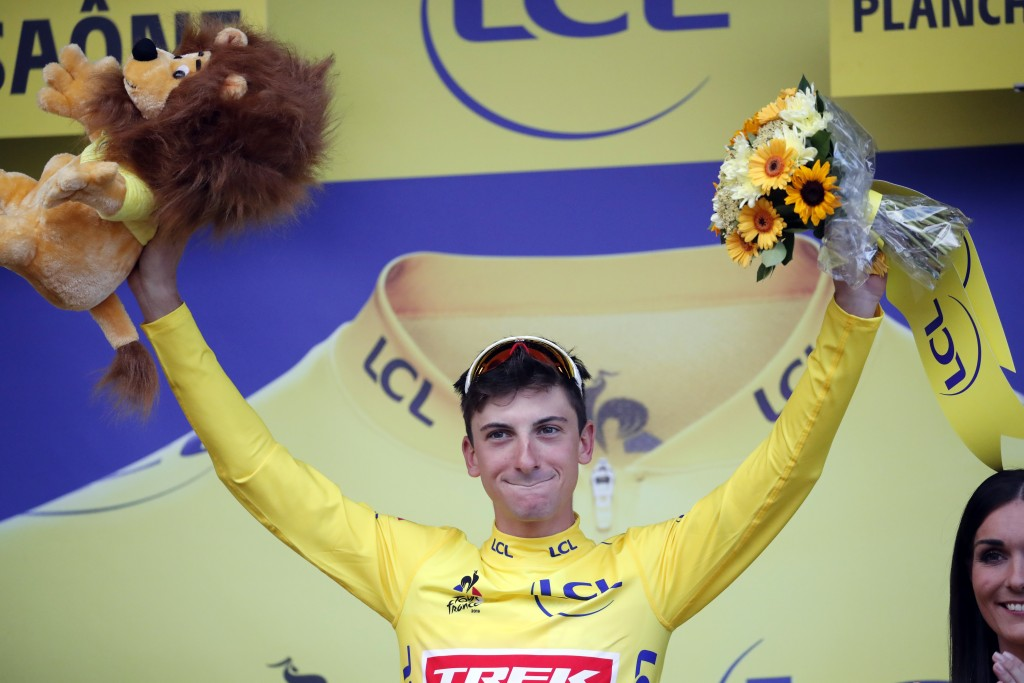 Italy's Giulio Ciccone celebrates with the overall leader's yellow jersey on the podium, at the end of the sixth stage of the Tour de France cycling r