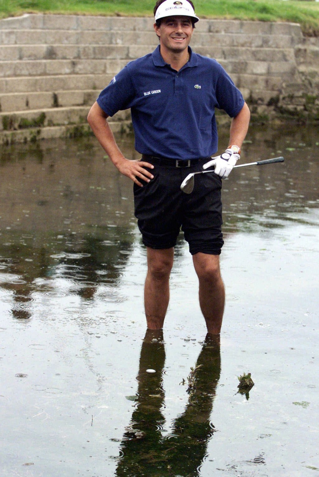 FILE - In this July 18, 1999, file photo, France's Jean Van de Velde smiles as he stands in the water of the Barry Burn that crosses the 18th fairway ...