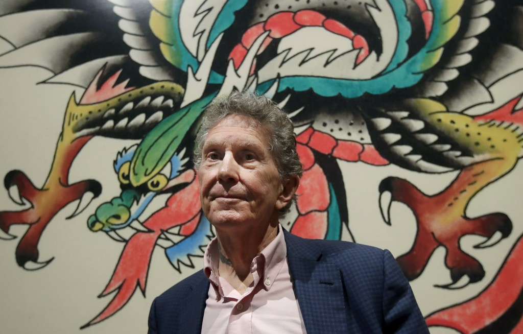 """In this Wednesday, July 10, 2019 photo, Ed Hardy poses for a photo during a media preview of """"Ed Hardy: Deeper than Skin"""" at the de Young Museum in Sa..."""
