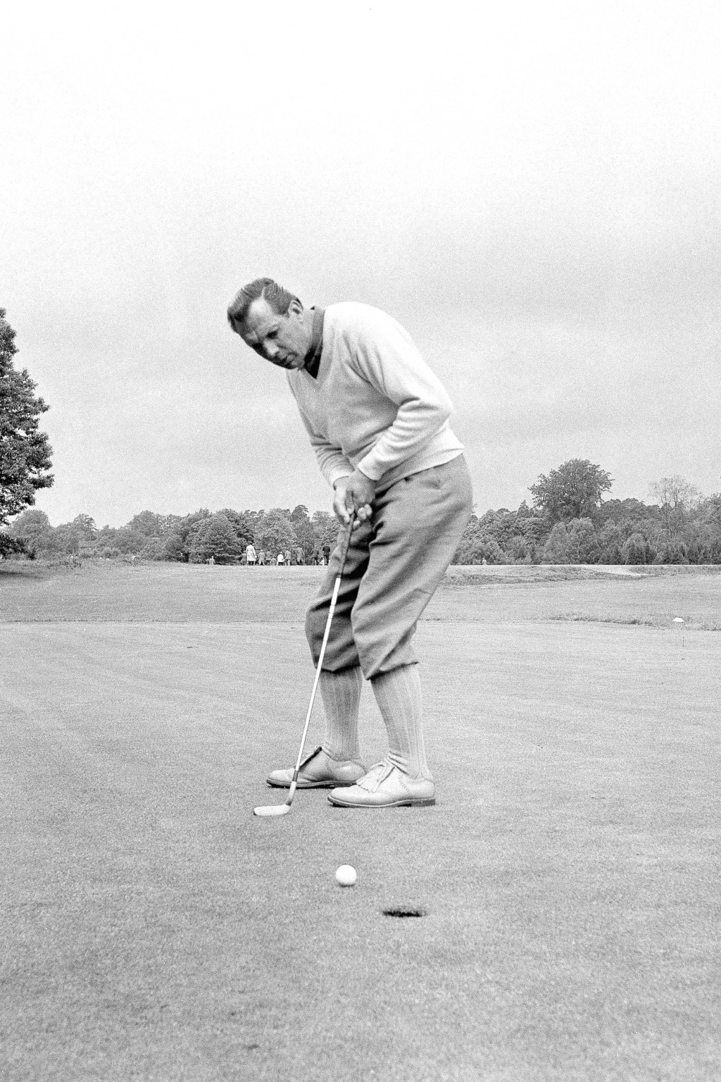 FILE - In this June 9, 1960, file photo, Max Faulkner putts at Wentworth Club in Virginia Water, England. The British Open returns to Royal Portrush o