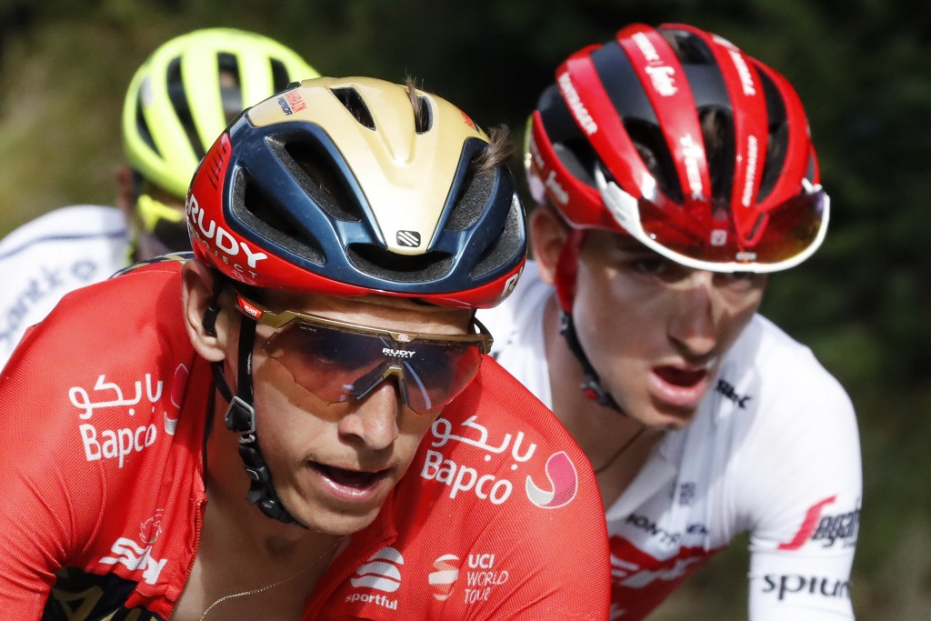 Italy's Giulio Ciccone, right, and Belgium's Dylan Teuns, climb La Planche des Belles Filles during the sixth stage of the Tour de France cycling race