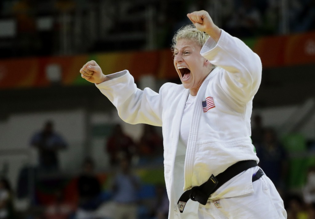 FILE - In this Thursday, Aug. 11, 2016, file photo, United States' Kayla Harrison celebrates after defeating France's Audrey Tcheumeo in the women's 7