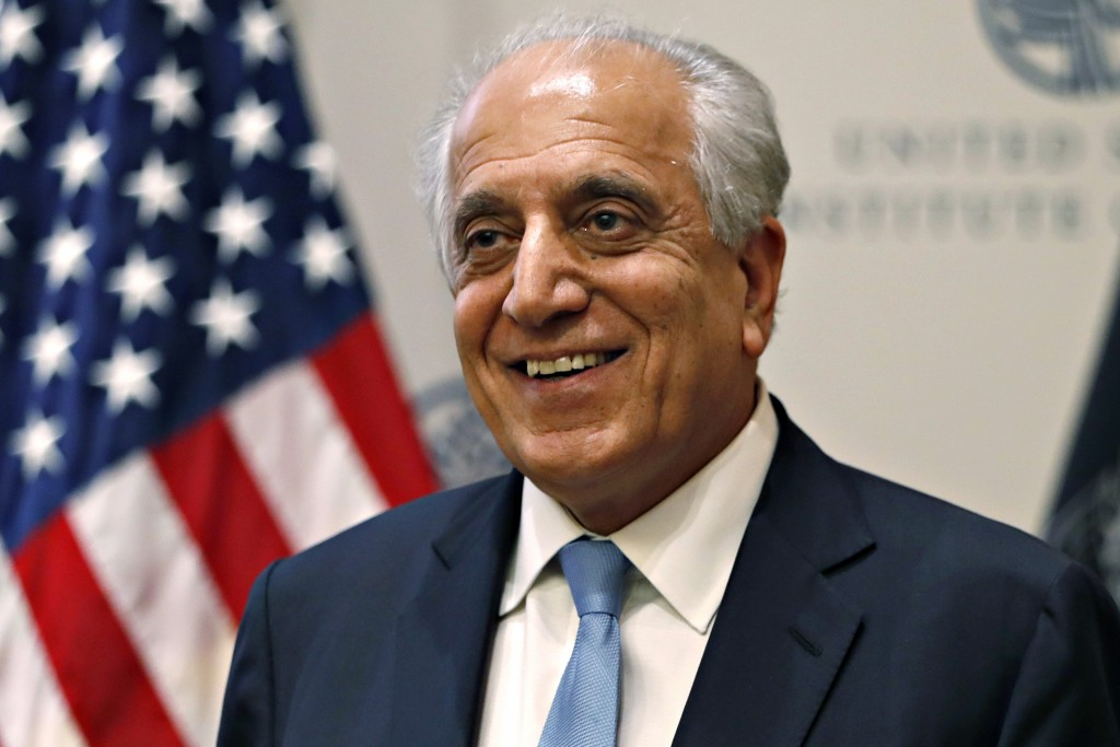 FILE - In this Feb. 8, 2019, file photo, Special Representative for Afghanistan Reconciliation Zalmay Khalilzad smiles at the U.S. Institute of Peace,...