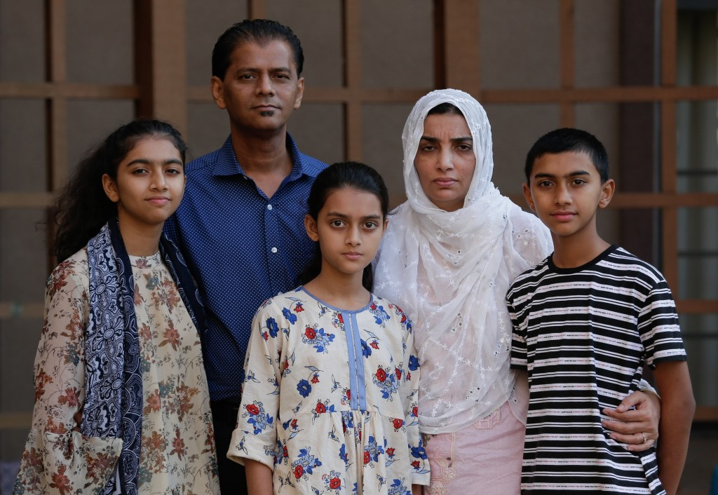 In this Wednesday July 10, 2019 photo, family members of Santa Fe High School shooting victim Sabika Aziz Sheikh, 17, pose at their home during an int
