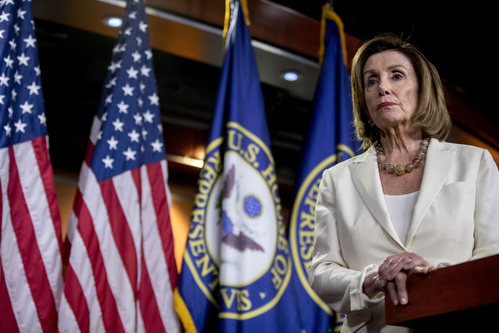 House Speaker Nancy Pelosi of Calif. listens to a ...
