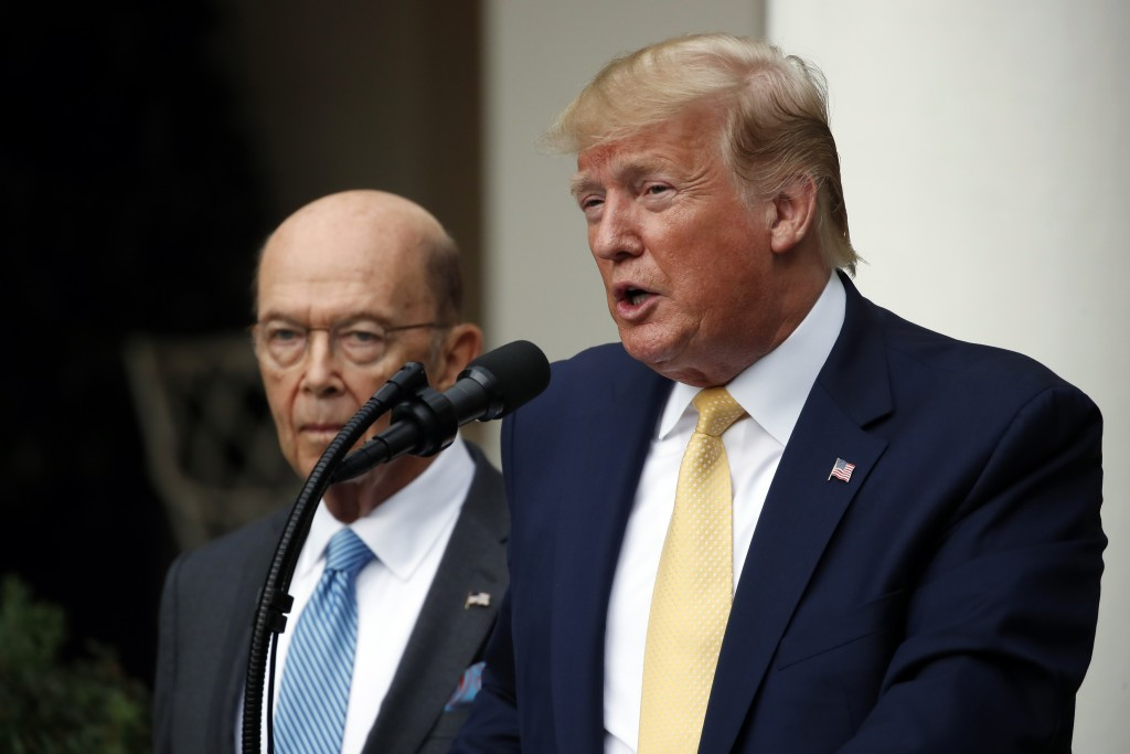 President Donald Trump is joined by Commerce Secretary Wilbur Ross as he speaks in the Rose Garden at the White House in Washington, Thursday, July 11