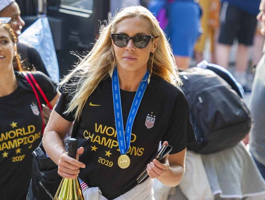 FILE - In this July 8, 2019 file photo, United States women's soccer team member Allie Long walks to a hotel Monday, July 8, 2019, in New York. The ce