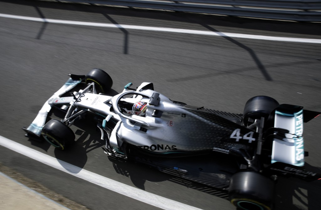 Mercedes driver Lewis Hamilton of Britain steers his car during the first free practice at the Silverstone racetrack, in Silverstone, England, Friday,