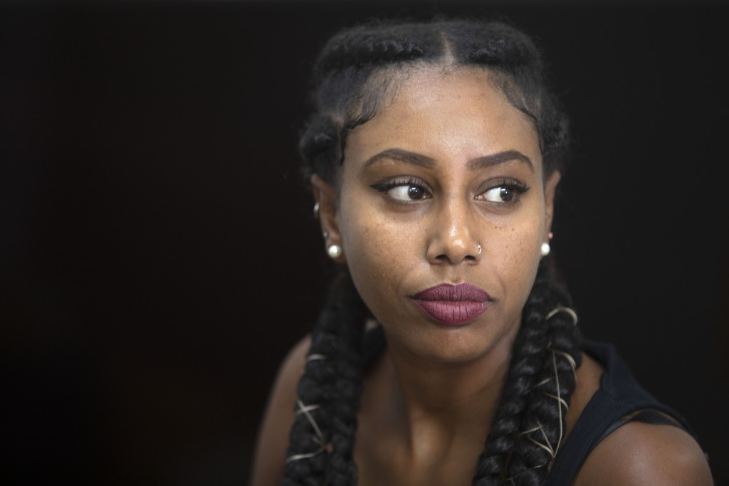 In this Sunday, July 7, 2019 photo, Ethiopian Israeli musician Yael Mentesnot gives an interview to The Associated Press, in her house in Tel Aviv, Is...
