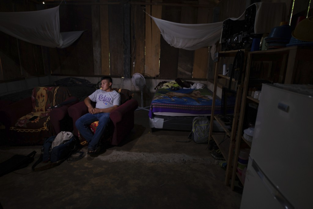 David Xol sits in his one-bedroom home in San Miguel El Limon, 475 kilometers (295 miles) away from Guatemala City, on Sunday, June, 23, 2019. The ACL