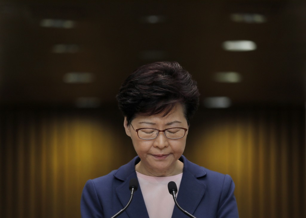 In this Tuesday, July 9, 2019, file photo, Hong Kong Chief Executive Carrie Lam pauses during a press conference in Hong Kong. Lam said Tuesday the ef
