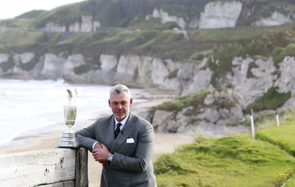 FILE - In this Tuesday, Oct. 20, 2015, file photo, Northern Ireland golfer and former Open golf winner Darren Clarke poses at Royal Portrush, Northern