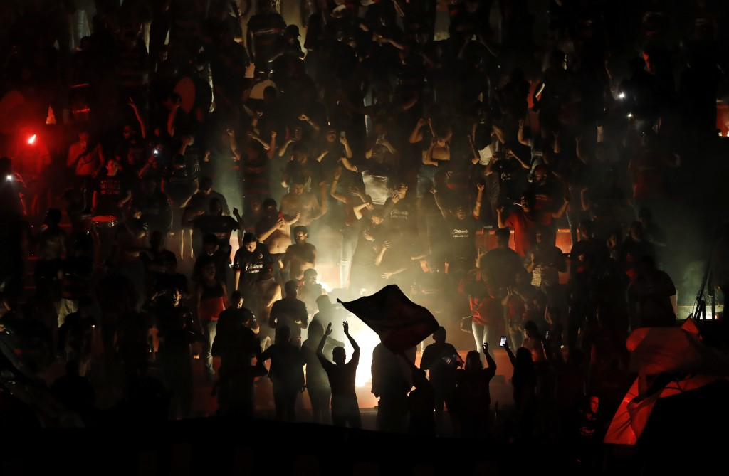 In this Wednesday, July 10, 2019 photo, fans for Tijuana celebrate after Tijuana defeated Boca Juniors 1-0 in a friendly soccer match, in Tijuana, Mex