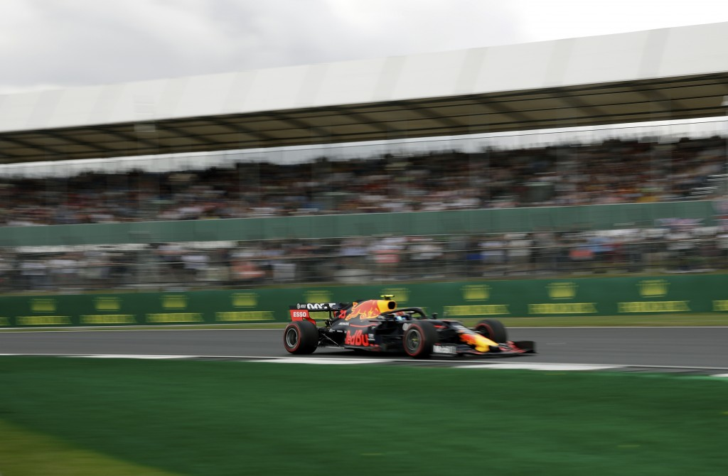 Red Bull driver Pierre Gasly of France steers his car during the first free practice at the Silverstone racetrack, in Silverstone, England, Friday, Ju...