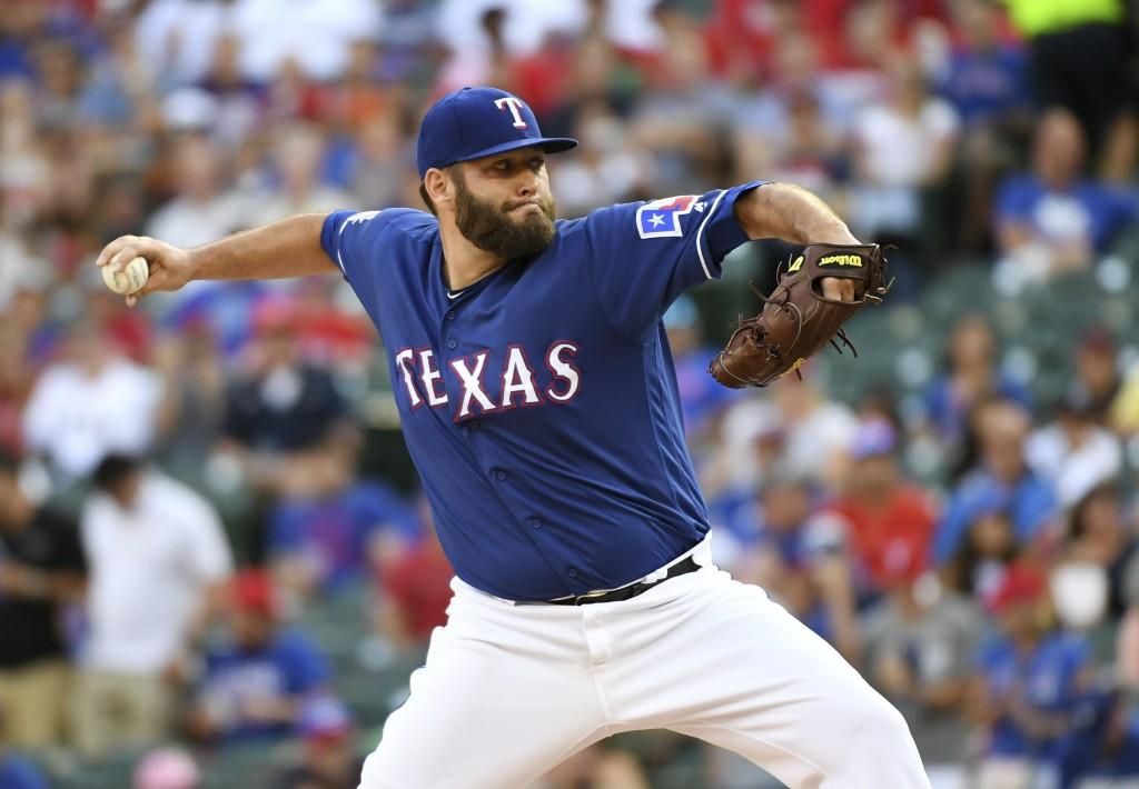 Texas Rangers starting pitcher Lance Lynn works against the Houston Astros during the first inning of a baseball game Thursday, July 11, 2019, in Arli...