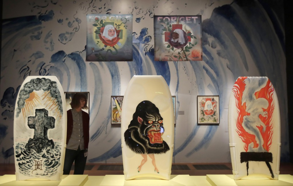 """In this Wednesday, July 10, 2019 photo, boogie boards designed by Ed Hardy are displayed during a media preview of """"Ed Hardy: Deeper than Skin"""" at the..."""