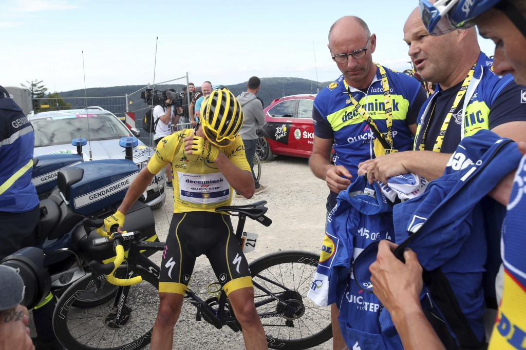 France's Julian Alaphilippe wearing the overall leader's yellow jersey reacts after he crossed the finish line of the sixth stage of the Tour de Franc