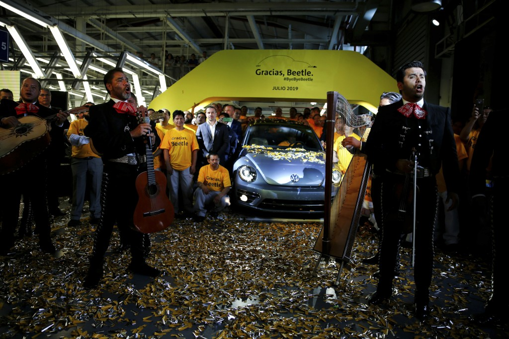 """In this Wednesday, July 10, 2019 photo, a mariachi band sings the classic Mexican tune """"Cielito Lindo"""", after the last Final Edition Beetle, this one"""