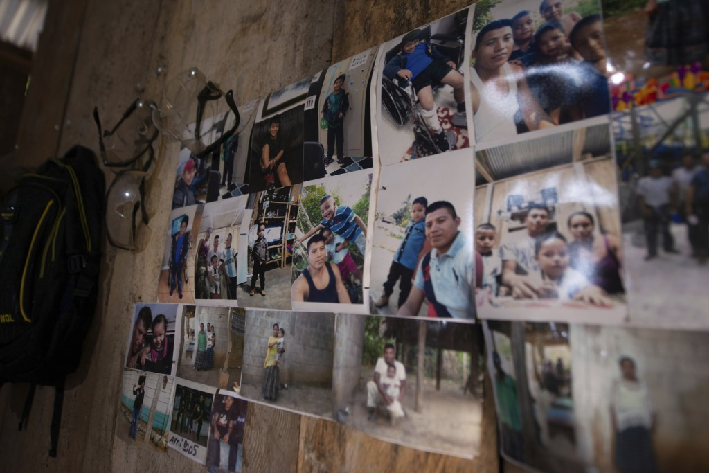 Family photos of David Xol hang on a wall in his one-bedroom home in San Miguel El Limon, 475 kilometers (295 miles) away from Guatemala City, Sunday,