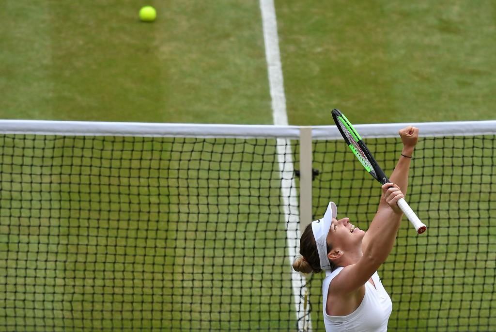 Romania's Simona Halep celebrates after beating Ukraine's Elina Svitolina in a Women's semifinal singles match on day ten of the Wimbledon Tennis Cham...