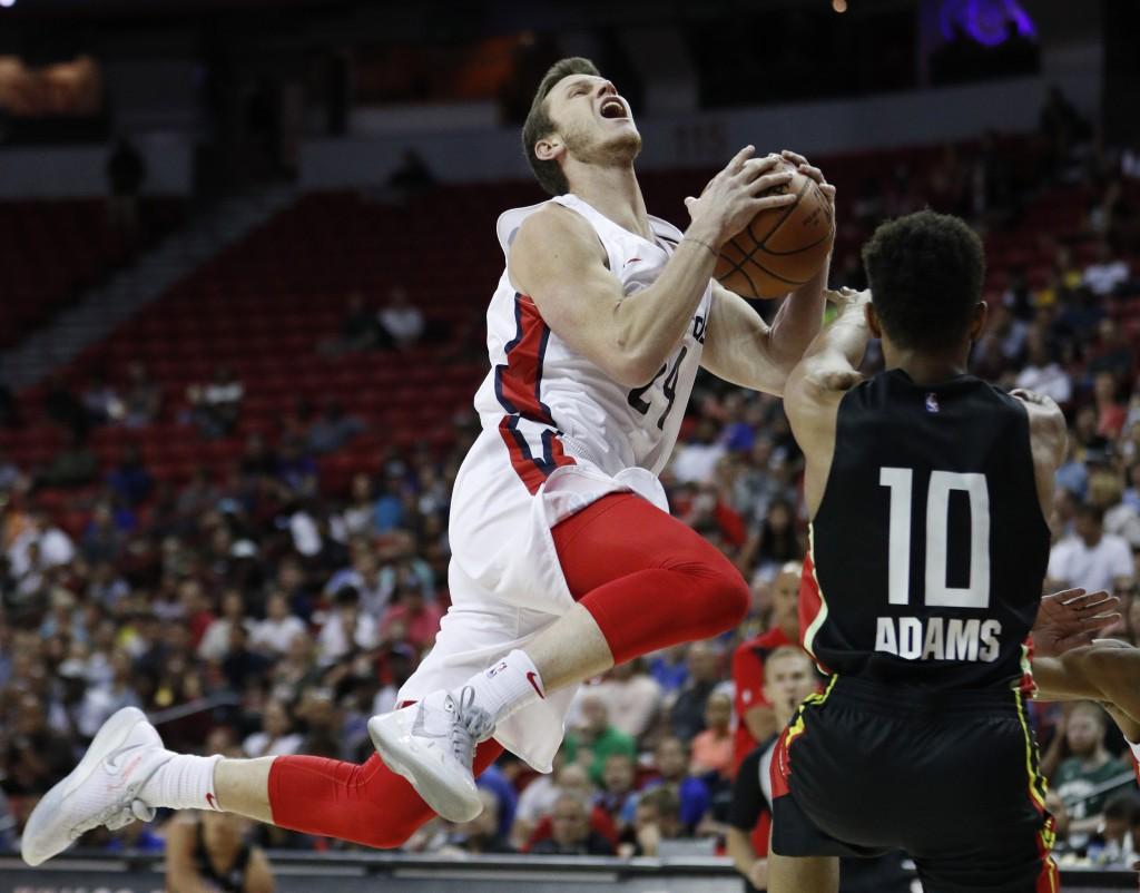 Atlanta Hawks' Jaylen Adams, right, fouls Washington Wizards' Garrison Mathews during the first half of an NBA summer league basketball game Thursday,...