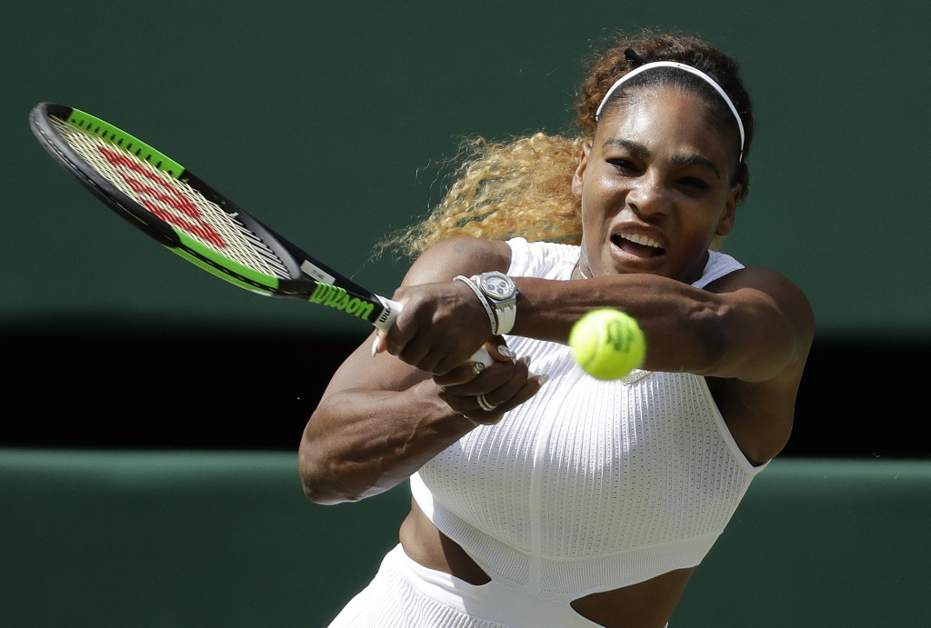 United States' Serena Williams returns to Czech Republic's Barbora Strycova in a Women's semifinal singles match on day ten of the Wimbledon Tennis Ch