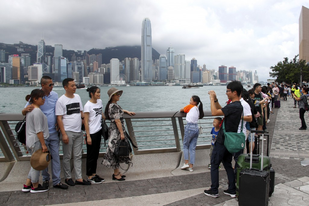 In this July 6, 2019, photo, Chinese tourists take...