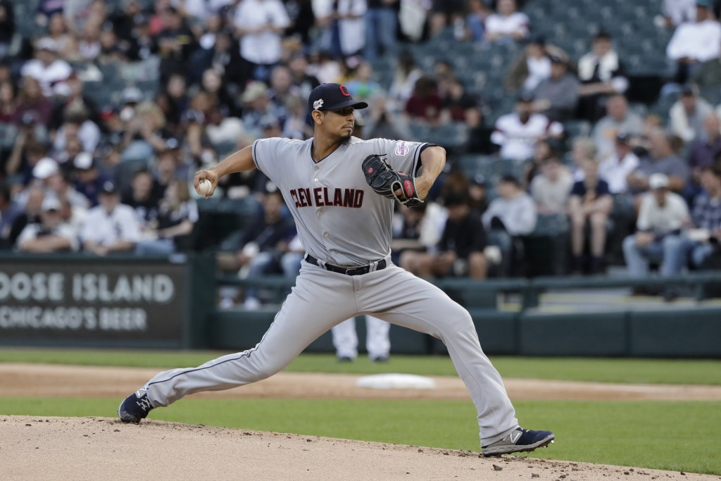 FILE - In this May 30, 2019, file photo, Cleveland Indians starting pitcher Carlos Carrasco throws against the Chicago White Sox during the first inni...