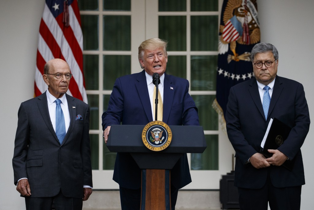 President Donald Trump, joined by Commerce Secretary Wilbur Ross, left, and Attorney General William Barr, speaks during an event about the census in
